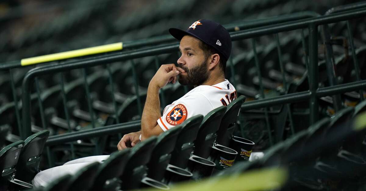 Houston Astros' Jose Altuve watches from the stands during a baseball game against the San Francisco Giants Wednesday, Aug. 12, 2020, in Houston. AP Photo/David J. Phillip)