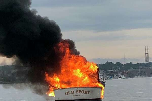 A 33-foot yacht burst into flames Thursday night in Norwalk Harbor.