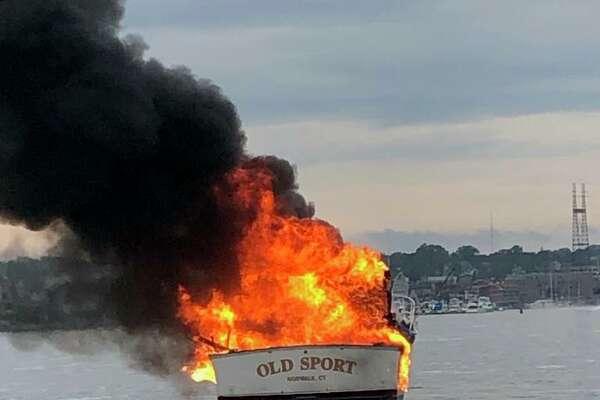 A 33-foot yacht burst into flames Thursday night in Norwalk Harbor.