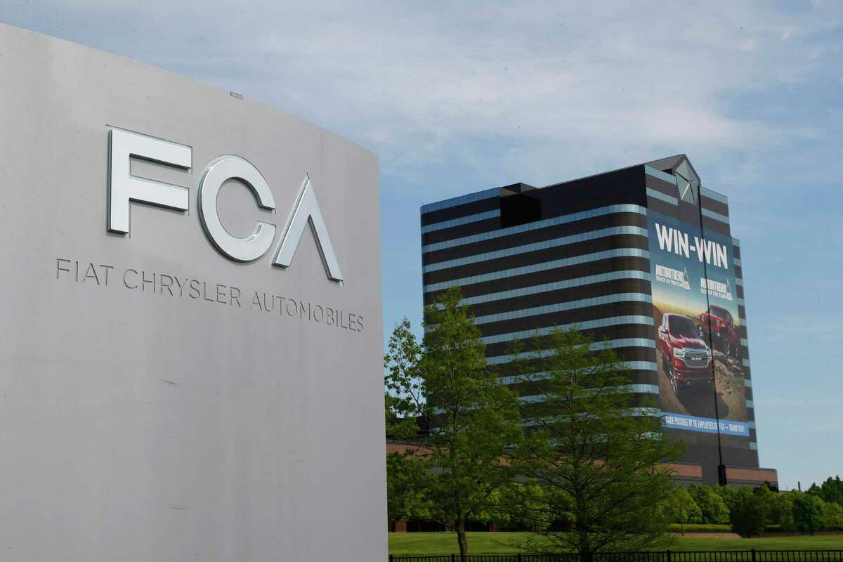 FILE - This May 27, 2019, file photo shows the Fiat Chrysler Automobiles world headquarters in Auburn Hills, Mich.Fiat Chrysler Automobiles is denying allegations by General Motors that FCA used foreign bank accounts to bribe union officials so they would stick GM with higher labor costs. In court papers filed Monday, Aug. 10, 2020, the Italian-American automaker said GM was using court records to make a€œdefamatory and baseless