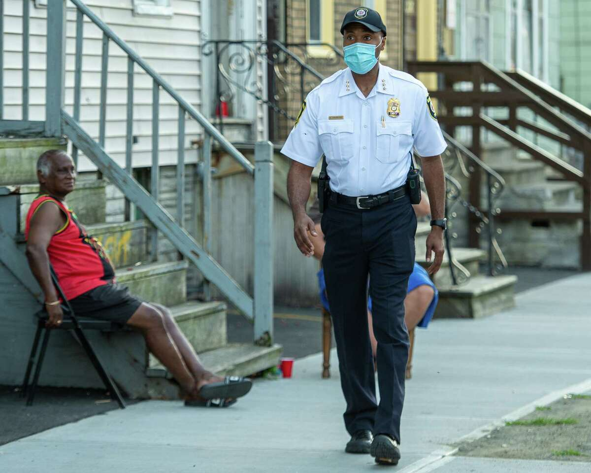 Albany Police Chief Eric Hawkins walks through the West Hill neighborhood in Albany, NY, with beat cops and members of the clergy to help build bonds between themselves and the community on Friday, Aug. 14, 2020 (Jim Franco/special to the Times Union.)