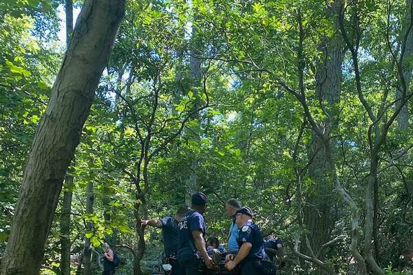 Hamden Fire personnel rescue a person at Sleeping Giant State Park in Hamden July 18, 2020