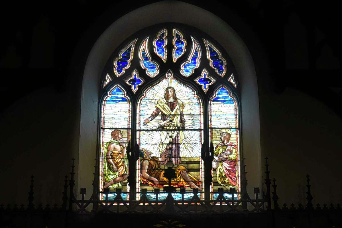 A view of the chancel stained glass window at Bethesda Episcopal Church on Wednesday, Aug. 12, 2020, in Saratoga Springs, N.Y. The stained glass window, titled, Christ, the miracle, at the pool of Bethesda, was installed around 1887. (Paul Buckowski/Times Union)