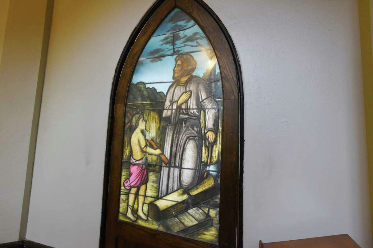 A view of a stained glass window at Bethesda Episcopal Church on Wednesday, Aug. 12, 2020, in Saratoga Springs, N.Y. The stained glass window shows a scene of a young Jesus Christ and his father Joseph. (Paul Buckowski/Times Union)