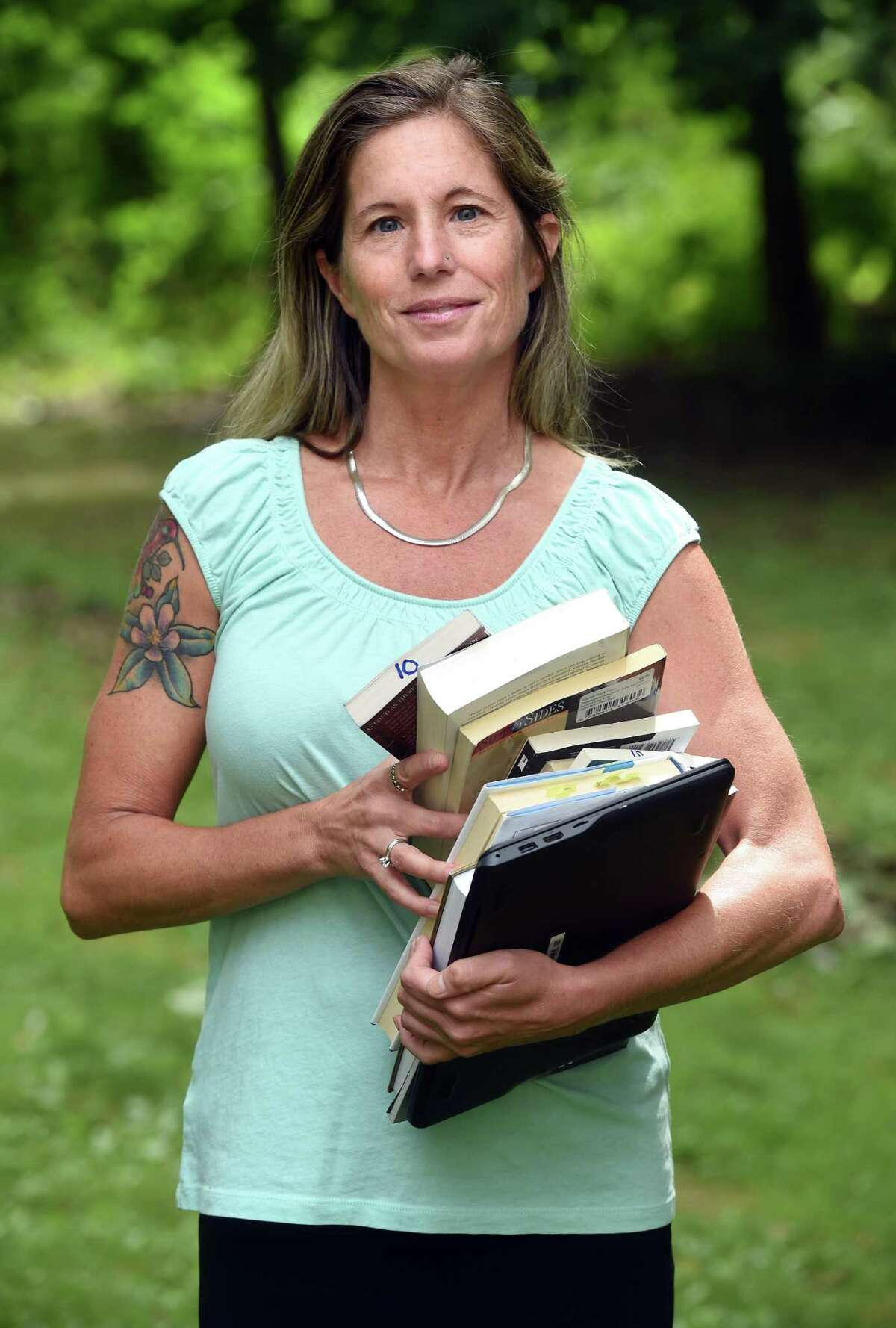 Former Bridgeport English teacher Denise D'Onofrio is photographed outside of her home in Orange on August 7, 2020.