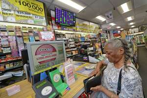 A customer buys Powerball lottery tickets at a store in Norwalk.