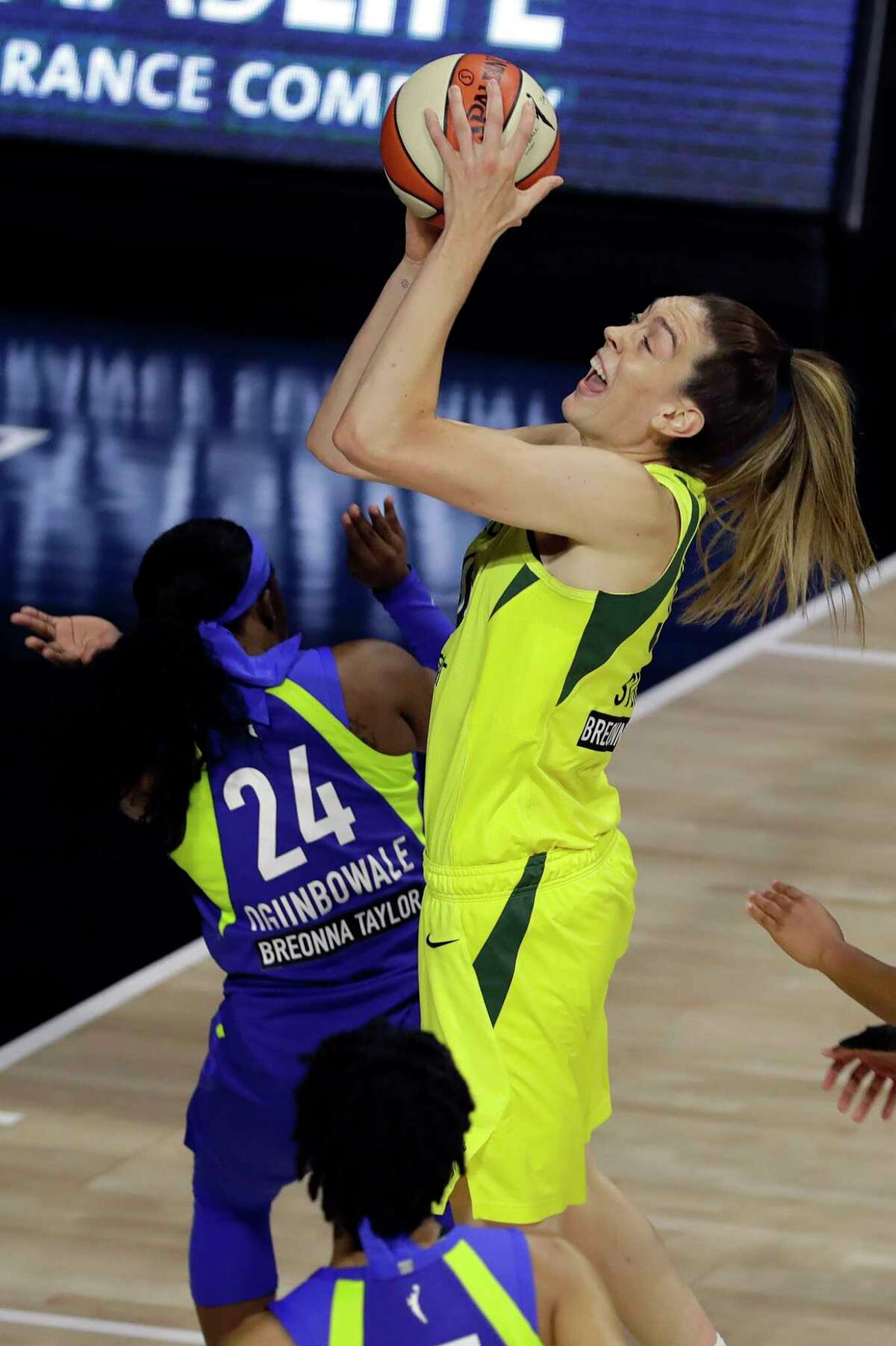 Seattle Storm forward Breanna Stewart (30) shoots over Dallas Wings guard Arike Ogunbowale (24) during the first half of a WNBA basketball game Friday, Aug. 14, 2020, in Bradenton, Fla. (AP Photo/Chris O'Meara)