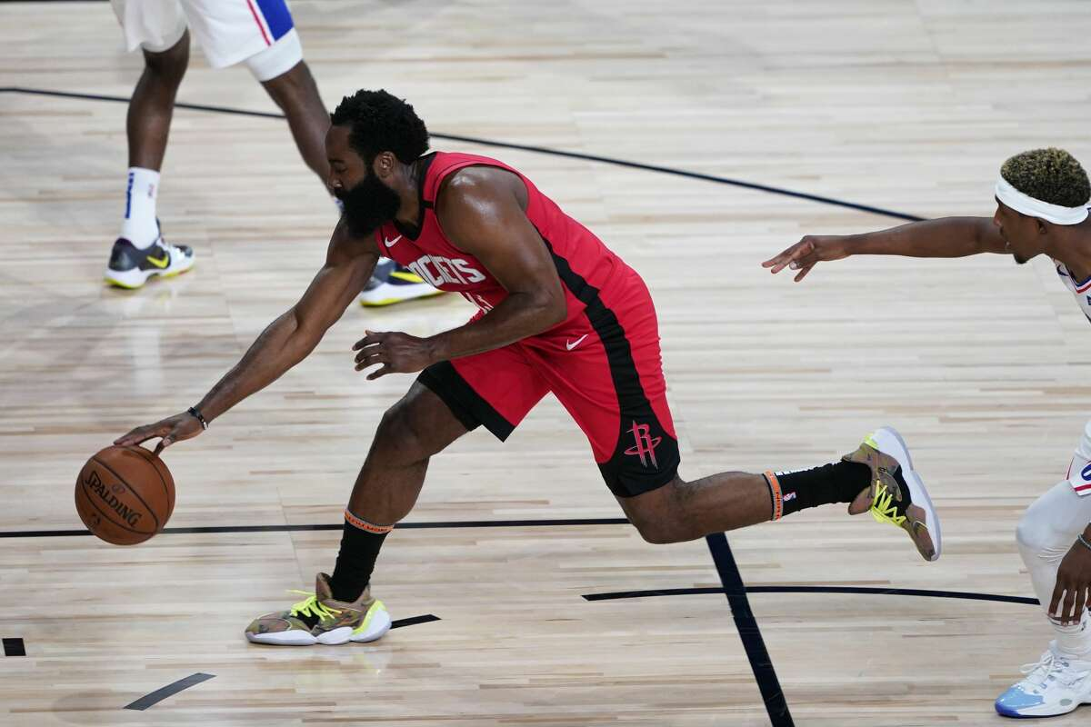 LAKE BUENA VISTA, FLORIDA - AUGUST 14: James Harden #13 of the Houston Rockets drives up the court against the Philadelphia 76ers during the first half of an NBA basketball game at the ESPN Wide World Of Sports Complex on August 14, 2020 in Lake Buena Vista, Florida. NOTE TO USER: User expressly acknowledges and agrees that, by downloading and or using this photograph, User is consenting to the terms and conditions of the Getty Images License Agreement. (Photo by Ashley Landis-Pool/Getty Images)