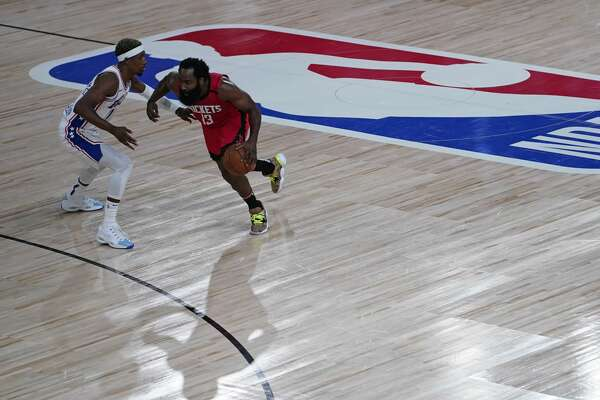 LAKE BUENA VISTA, FLORIDA - AUGUST 14: James Harden #13 of the Houston Rockets drives up the court around Josh Richardson #0 of the Philadelphia 76ers during the first half of an NBA basketball game at the ESPN Wide World Of Sports Complex on August 14, 2020 in Lake Buena Vista, Florida. NOTE TO USER: User expressly acknowledges and agrees that, by downloading and or using this photograph, User is consenting to the terms and conditions of the Getty Images License Agreement. (Photo by Ashley Landis-Pool/Getty Images)