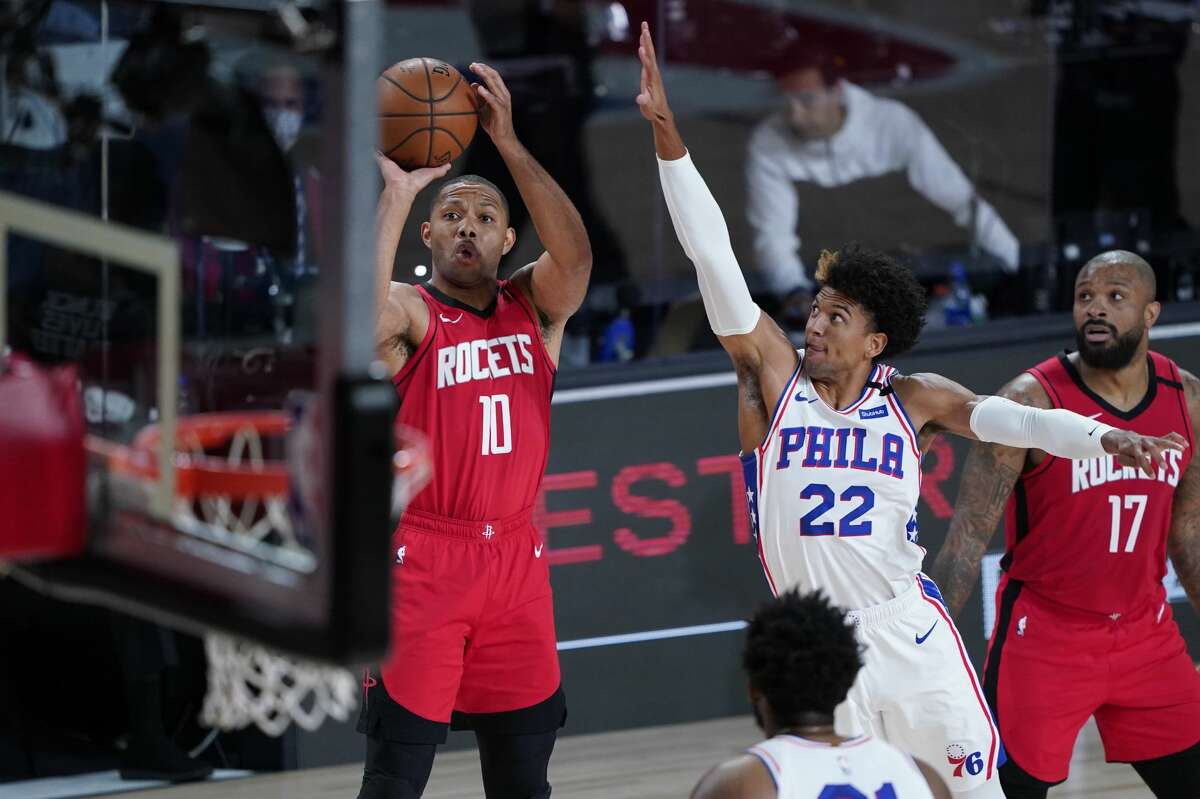 Eric Gordon #10 of the Houston Rockets shoots over Matisse Thybulle #22 of the Philadelphia 76ers during the first half of an NBA basketball game at the ESPN Wide World Of Sports Complex on August 14, 2020 in Lake Buena Vista, Florida.