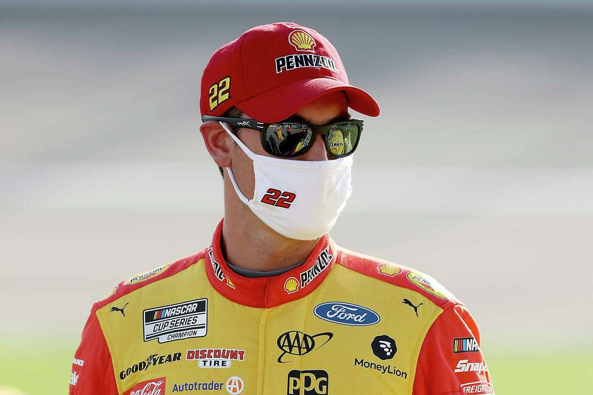 KANSAS CITY, KANSAS - JULY 23: Joey Logano, driver of the #22 Shell Pennzoil Ford, waits on the grid prior to the NASCAR Cup Series Super Start Batteries 400 Presented by O'Reilly Auto Parts at Kansas Speedway on July 23, 2020 in Kansas City, Kansas. (Photo by Jamie Squire/Getty Images)