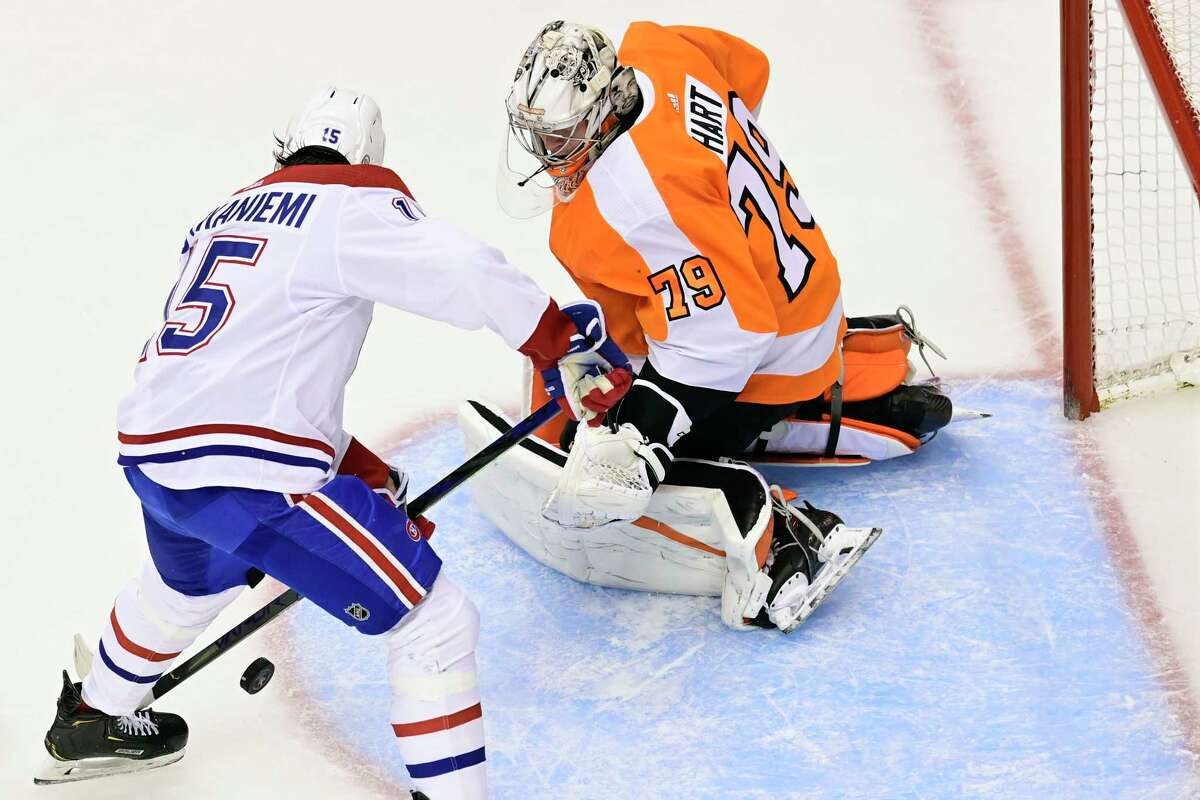 Montreal Canadiens centre Jesperi Kotkaniemi (15) scores on Philadelphia Flyers goaltender Carter Hart (79) during the first period of an NHL Eastern Conference Stanley Cup hockey playoff game in Toronto, Friday, Aug. 14, 2020. (Frank Gunn/The Canadian Press via AP)