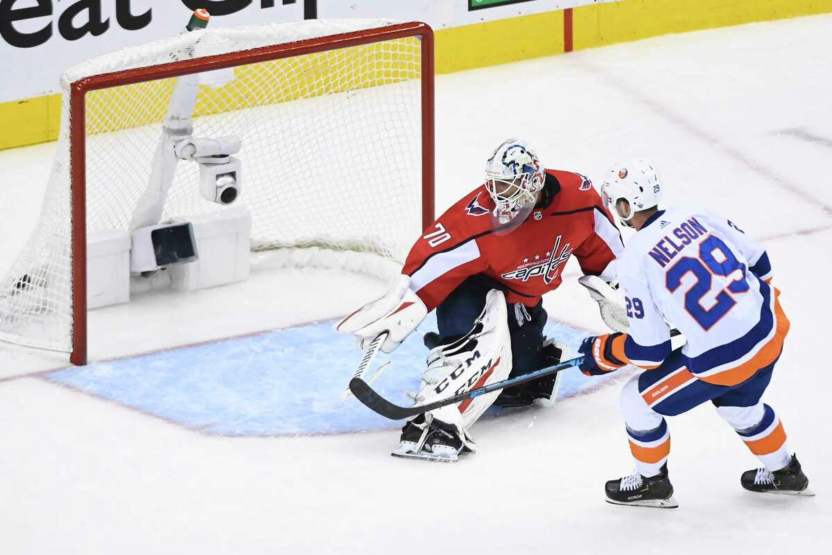 New York Islanders centre Brock Nelson (29) scores on Washington Capitals goaltender Braden Holtby (70) during the second period of an NHL Eastern Conference Stanley Cup hockey playoff game in Toronto, Friday, Aug. 14, 2020. (Nathan Denette/The Canadian Press via AP)