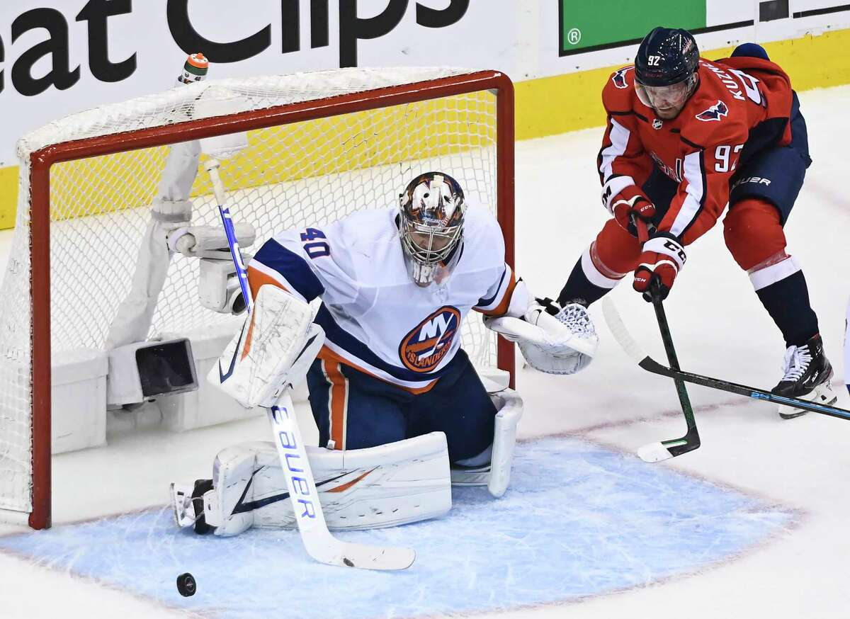 New York Islanders goaltender Semyon Varlamov (40) makes a pad-save against Washington Capitals center Evgeny Kuznetsov (92) during third-period NHL Eastern Conference Stanley Cup playoff hockey action in Toronto, Friday, Aug. 14, 2020. (Nathan Denette/The Canadian Press via AP)