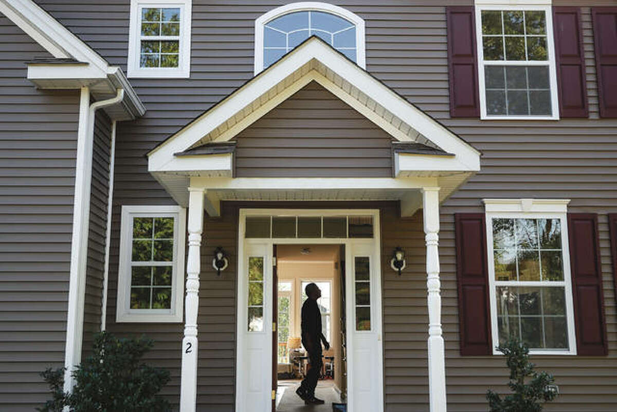 Anil Lilly tours his new home. The coronavirus pandemic helped shape the housing market by influencing everything from the direction of mortgage rates to the inventory of homes on the market to the types of homes in demand and the desired locations.