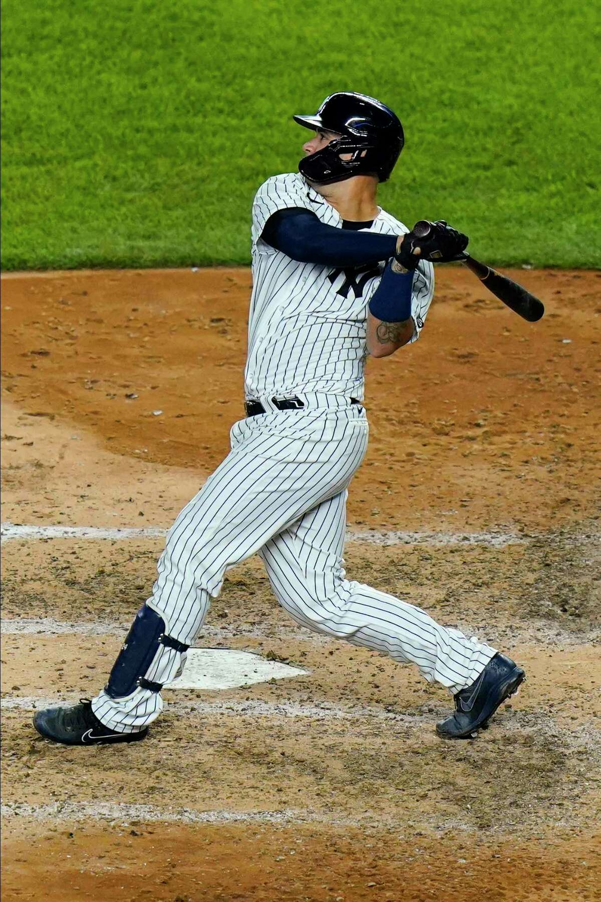 New York Yankees' Gary Sanchez follows through on a two-run home run during the fifth inning of a baseball against the Boston Red Sox game Friday, Aug. 14, 2020, in New York. (AP Photo/Frank Franklin II)