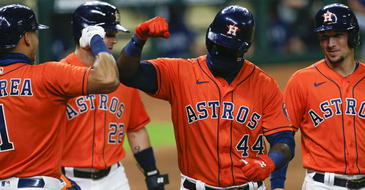 Houston Astros designated hitter Yordan Alvarez (44) celebrates with teammates after hitting a three-run home run against the Seattle Mariners during the first inning of the MLB game at Minute Maid Park on Friday, Aug. 14, 2020, in Houston.