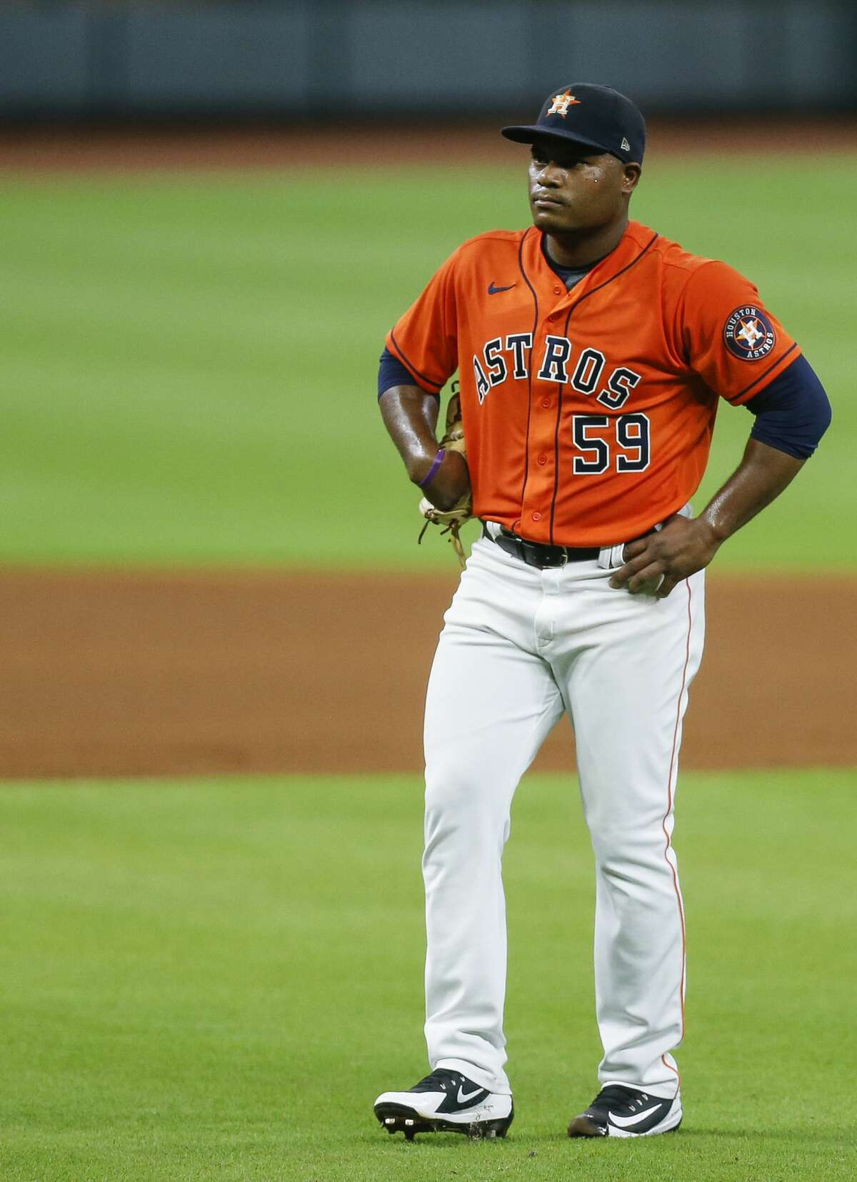 Houston Astros starting pitcher Framber Valdez (59) reacts after giving up the third walk of the first inning against the Seattle Mariners during an MLB game at Minute Maid Park on Friday, Aug. 14, 2020, in Houston.