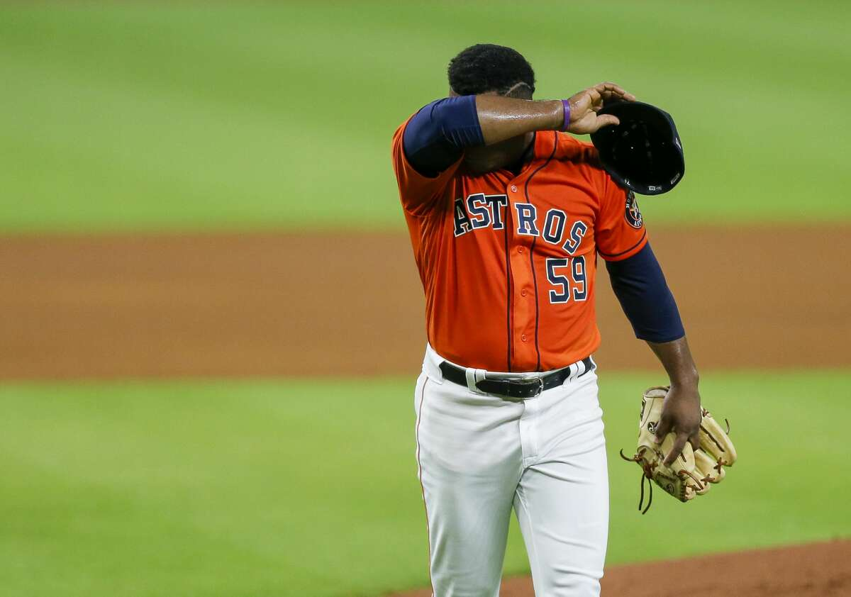 Houston Astros starting pitcher Framber Valdez (59) walks back to the dugout after pithing in the first inning of the MLB game against the Seattle Mariners at Minute Maid Park on Friday, Aug. 14, 2020, in Houston.