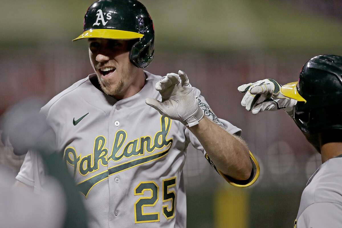 Oakland Athletics' Stephen Piscotty (25) celebrates after hitting a grand slam off San Francisco Giants' Trevor Gott in the ninth inning of a baseball game, Friday, Aug. 14, 2020, in San Francisco. (AP Photo/Ben Margot)