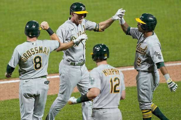 SAN FRANCISCO, CALIFORNIA - AUGUST 14: Stephen Piscotty #25, Khris Davis #2, Sean Murphy #12 and Robbie Grossman #8 of the Oakland Athletics celebrate after Piscotty hit a game-tying grand slam against the San Francisco Giants in the top of the ninth inning at Oracle Park on August 14, 2020 in San Francisco, California. (Photo by Thearon W. Henderson/Getty Images)