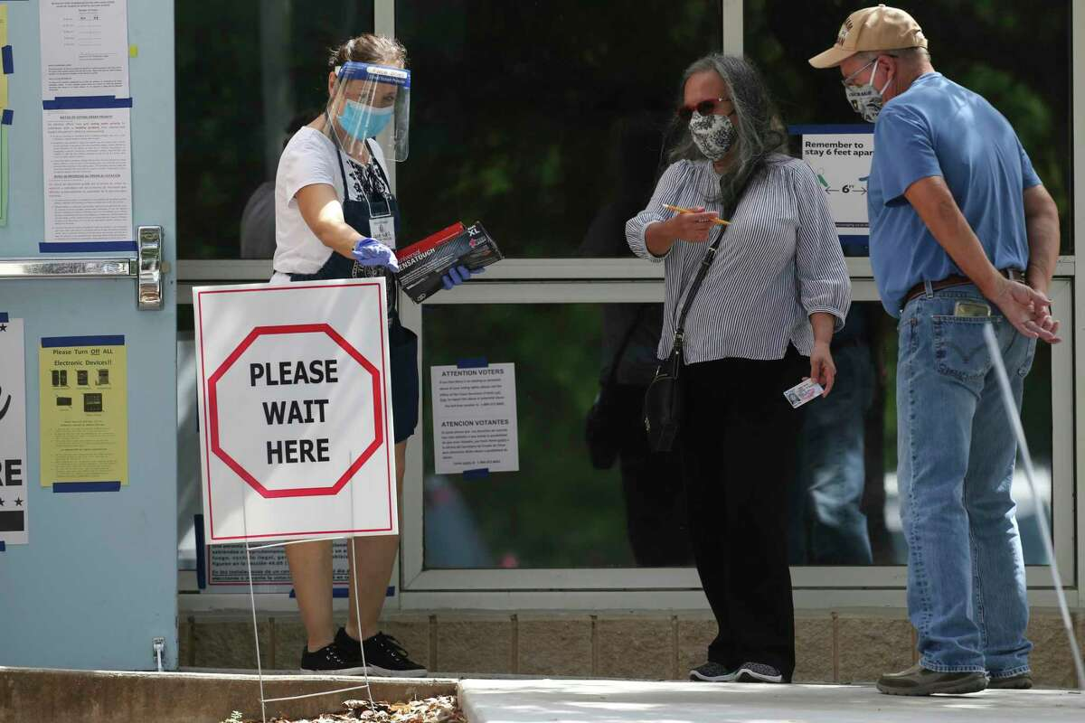 People show up to vote during Election Day of the primary runoffs at Brook Hollow Library Tuesday, July 14, 2020.