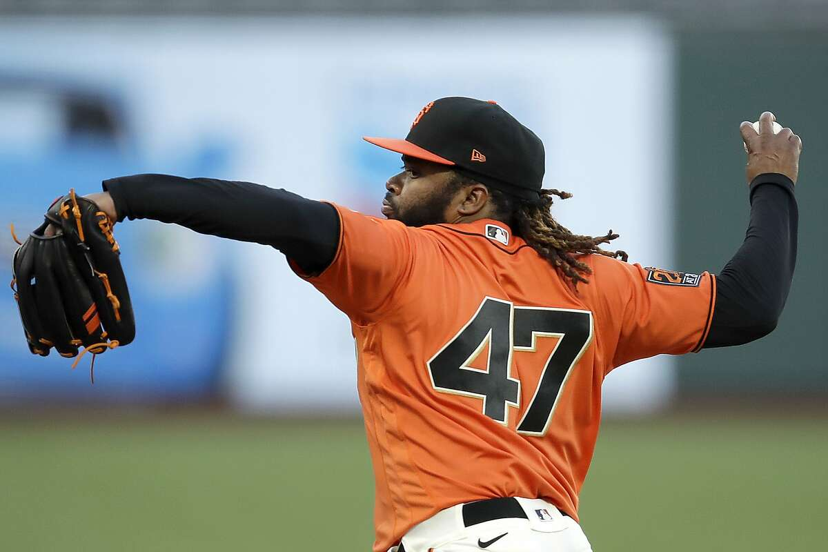 San Francisco Giants pitcher Johnny Cueto works against the Oakland Athletics in the first inning of a baseball game Friday, Aug. 14, 2020, in San Francisco. (AP Photo/Ben Margot)