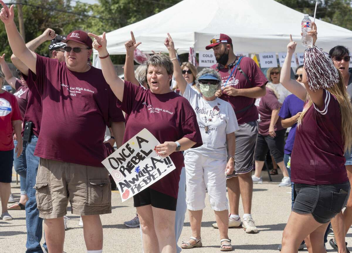 Lee High School alumni, parents, students and supporters come together 8/15/2020 in the Lee High student parking lot to gather signatures in support of keeping the name of Lee High School. Tim Fischer/Reporter-Telegram