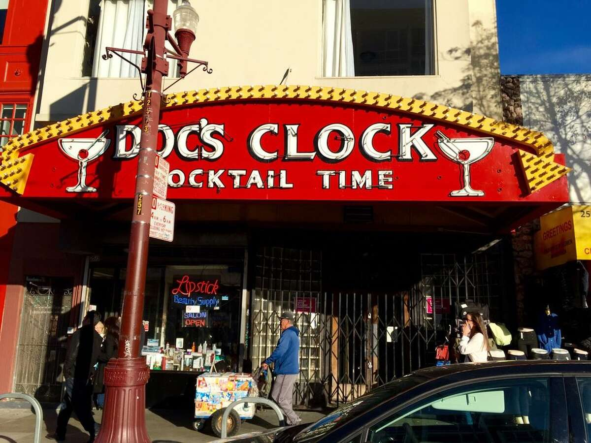 Mission bar Doc's Clock returned to serve customers drinks outdoors under its famous sign.