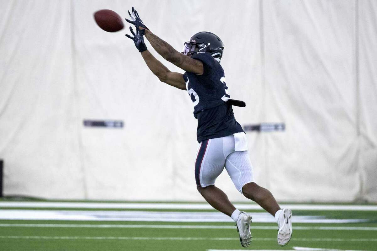 Houston Texans safety Jonathan Owens reaches out to make a catch during an NFL training camp football practice Saturday, Aug. 15, 2020, at The Houston Methodist Training Center in Houston.