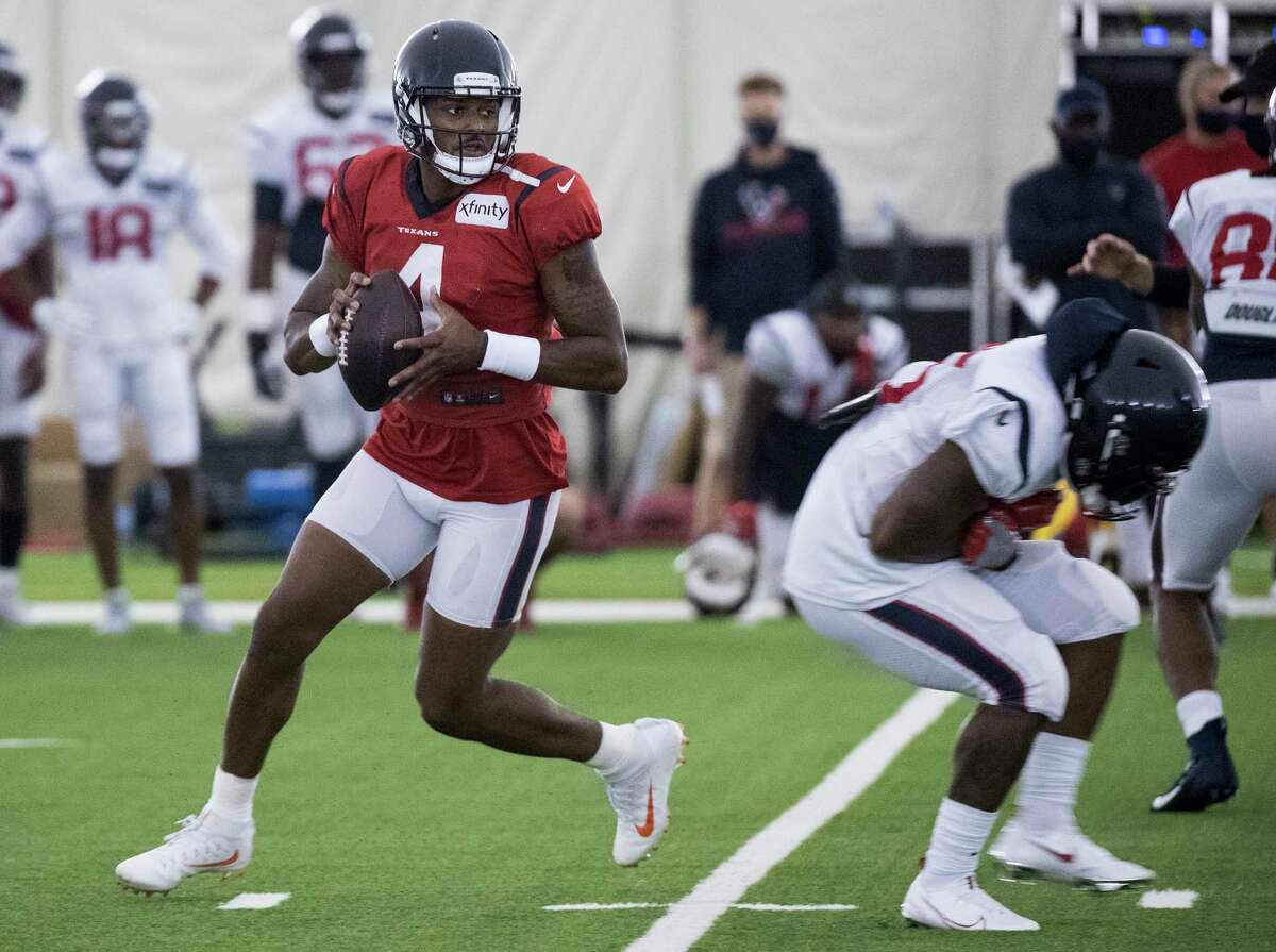 Houston Texans quarterback Deshaun Watson (4) rolls out to pass during an NFL training camp football practice Saturday, Aug. 15, 2020, at The Houston Methodist Training Center in Houston.