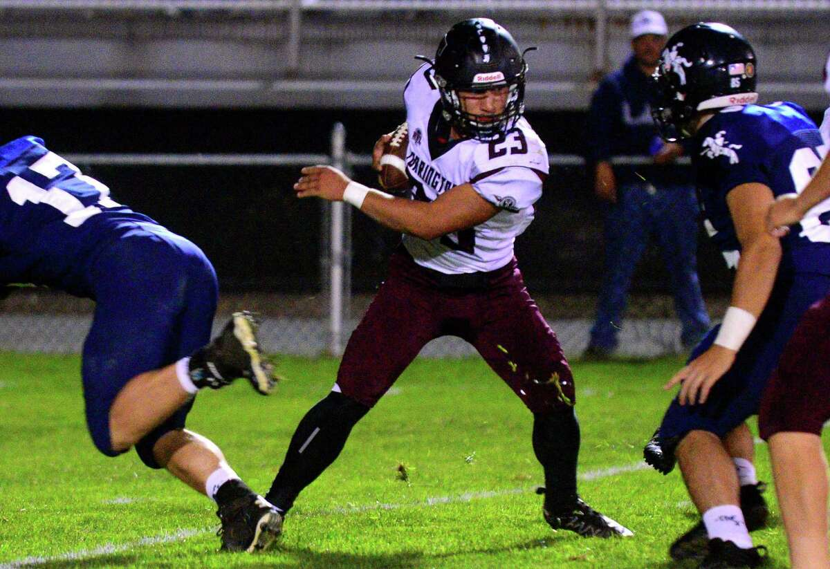 High school football action between Ansonia and Torrington in Ansonia on Sept. 29, 2017. There are plenty of logistics and challeges facing fall sports following a week of decisions from the CIAC, with more decisions to come.
