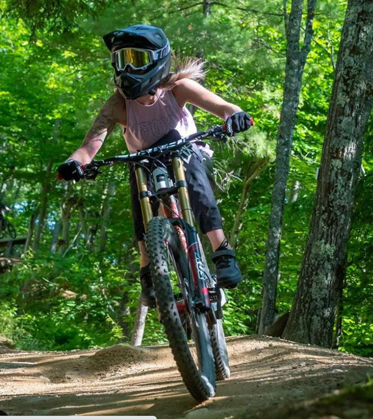 Lindsey Runkel, a registered nurse on the liver and kidney transplant unit at Yale New Haven Hospital, still rides a mountain bike after becoming paralyzed in a biking accident in 2014.