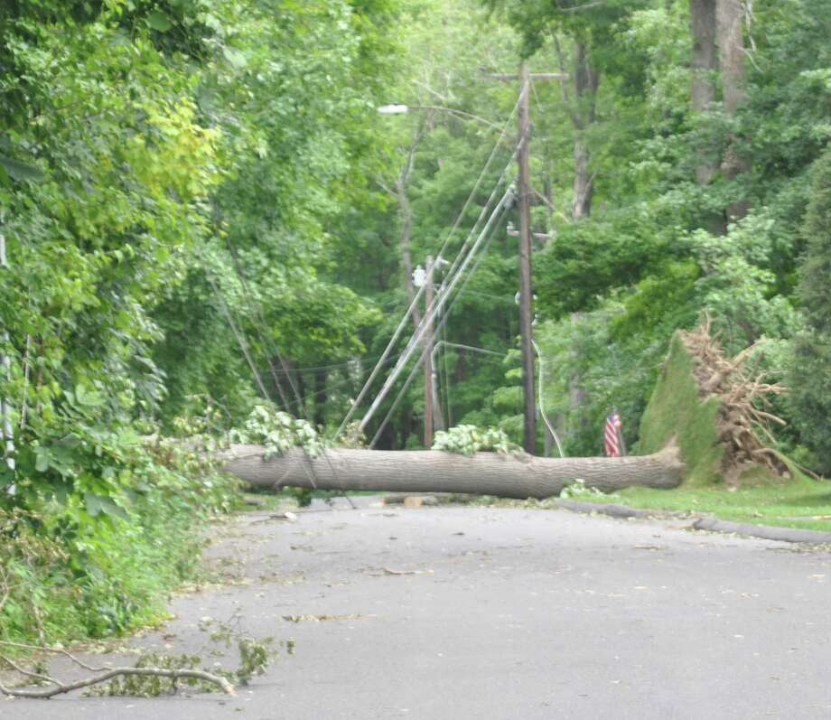 A fallen tree brought wires down across Rockwell Road, one several roads in Ridgefield that First Selectman Rudy Marconi said was closed at either end, trapping residents, in last week's Storm Isaias. Photo: Macklin Reid