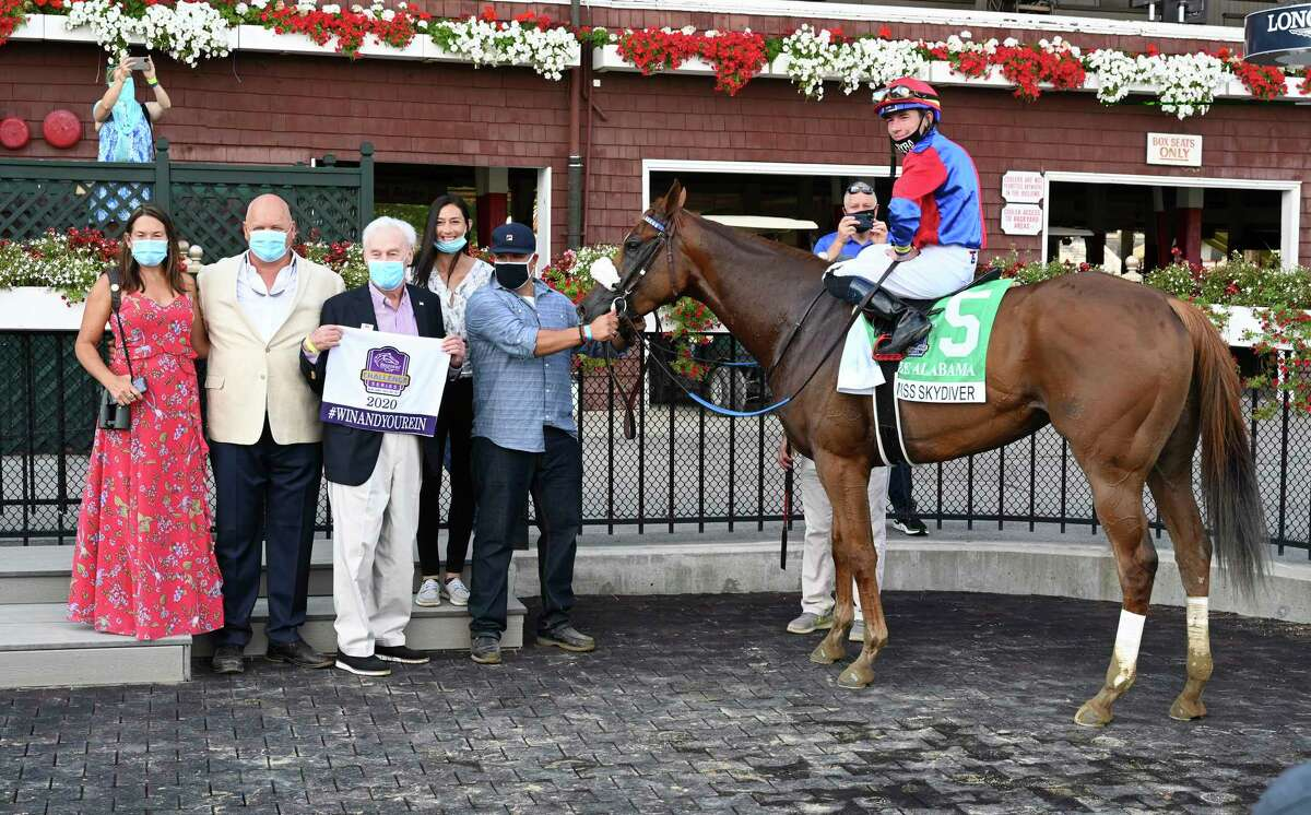 Swiss Skydiver with jockey Tyler Gafalione in the irons convincingly won the 140th running of The Alabama Saturday Aug.15, 2020 at the Saratoga Race Course in Saratoga Springs, N.Y. From left Sherri McPeek, Kenny McPeek, Peter Callahan. Photo by Skip Dickstein/Special to the Times Union