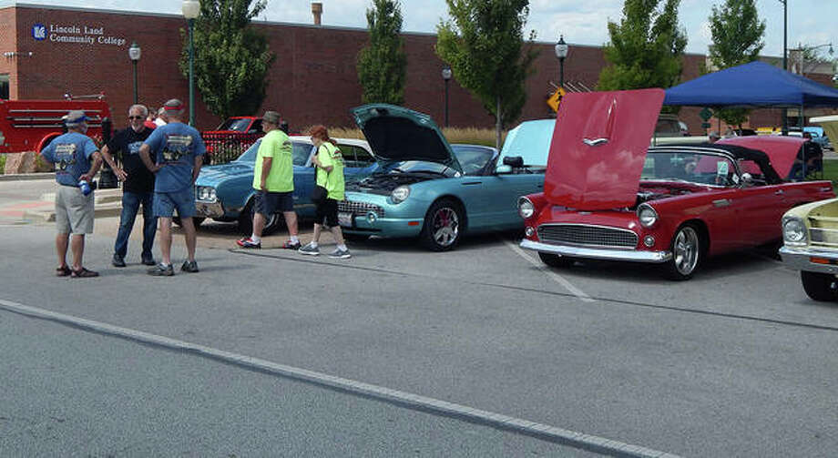 Nearly 200 cars of all types took part in Saturday's Morton Avenue Misfits Car Show and Cruise. Cars lined the downtown Jacksonville plaza for judging in 20 classes. Photo: Angela Bauer | Journal-Courier