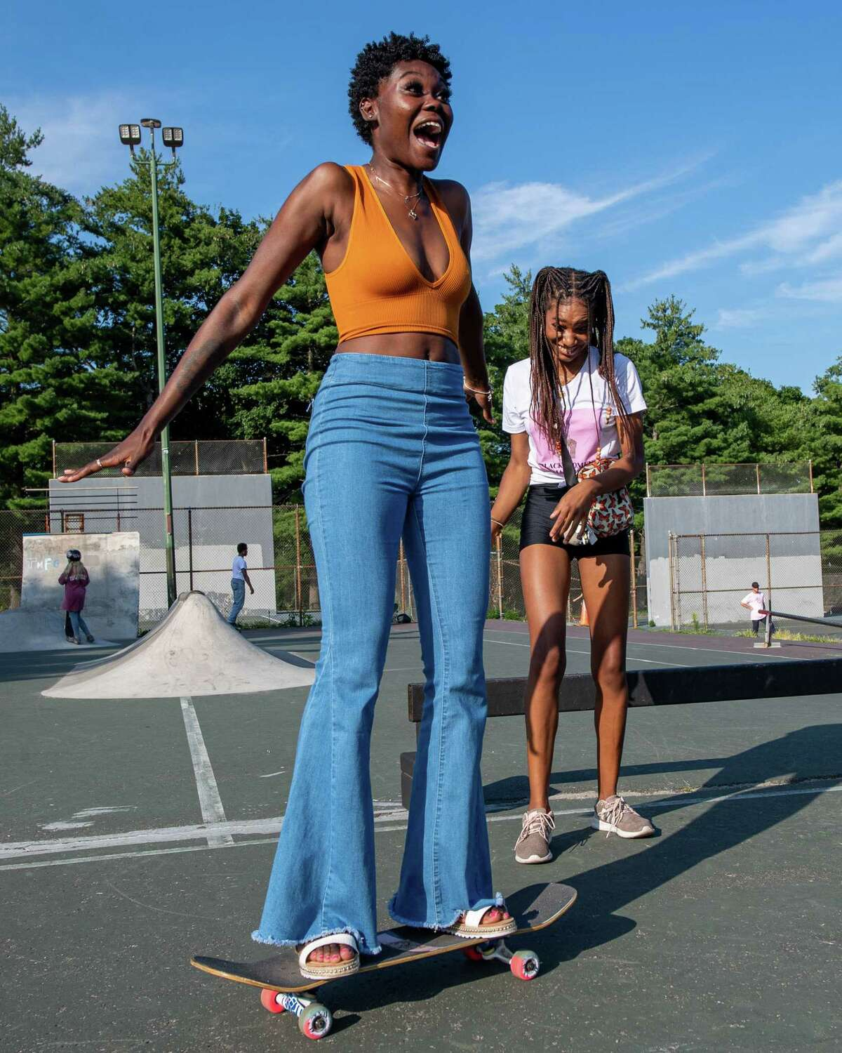Destiny Harris gets a push from Chantelleigh Graham during a meet-up hosted by Noteworthy Resources to introduce women, youth, members of the LGBTQ+ community and their allies to the sport of skateboarding at the Albany Skate Park in Washington Park in Albany, NY, on Saturday, Aug. 15, 2020 (Jim Franco/special to the Times Union.)