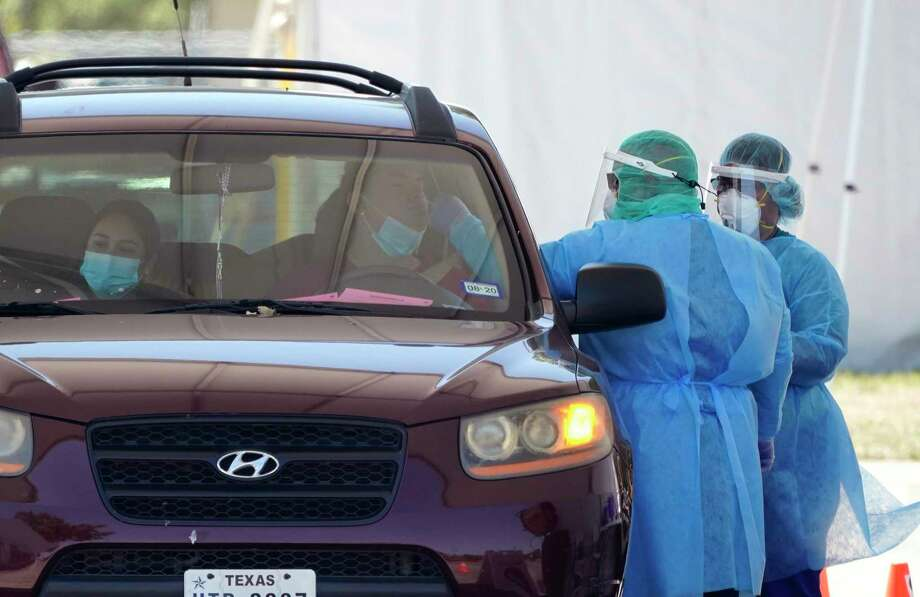 Medical personnel administer COVID-19 testing at a drive-through site in San Antonio. Photo: Eric Gay, STF / Associated Press / Copyright 2020 The Associated Press. All rights reserved.