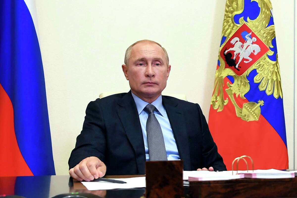 Russian President Vladimir Putin attends a meeting via video conference at the Novo-Ogaryovo residence outside Moscow, Russia, Friday, Aug. 14, 2020. (Alexei Nikolsky, Sputnik, Kremlin Pool Photo via AP)