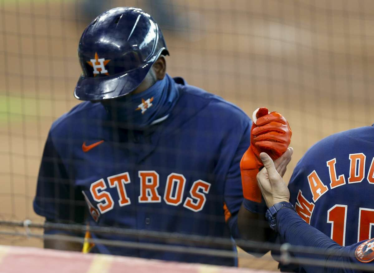 Houston Astros designated hitter Yordan Alvarez (44) enters the dugout after scoring against the Seattle Mariners during the second inning of an MLB game at Minute Maid Park on Saturday, Aug. 15, 2020, in Houston.