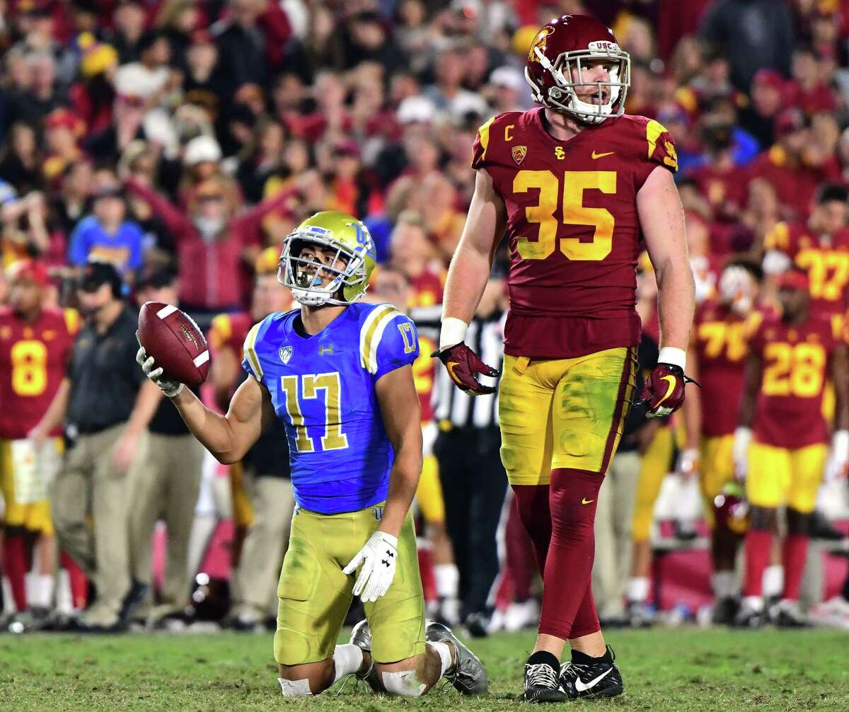 LOS ANGELES, CA - NOVEMBER 18: Christian Pabico #17 of the UCLA Bruins reacts to his dropped pass in front of Cameron Smith #35 of the USC Trojans during the fourth quarter at Los Angeles Memorial Coliseum on November 18, 2017 in Los Angeles, California. (Photo by Harry How/Getty Images) ORG XMIT: 775056995