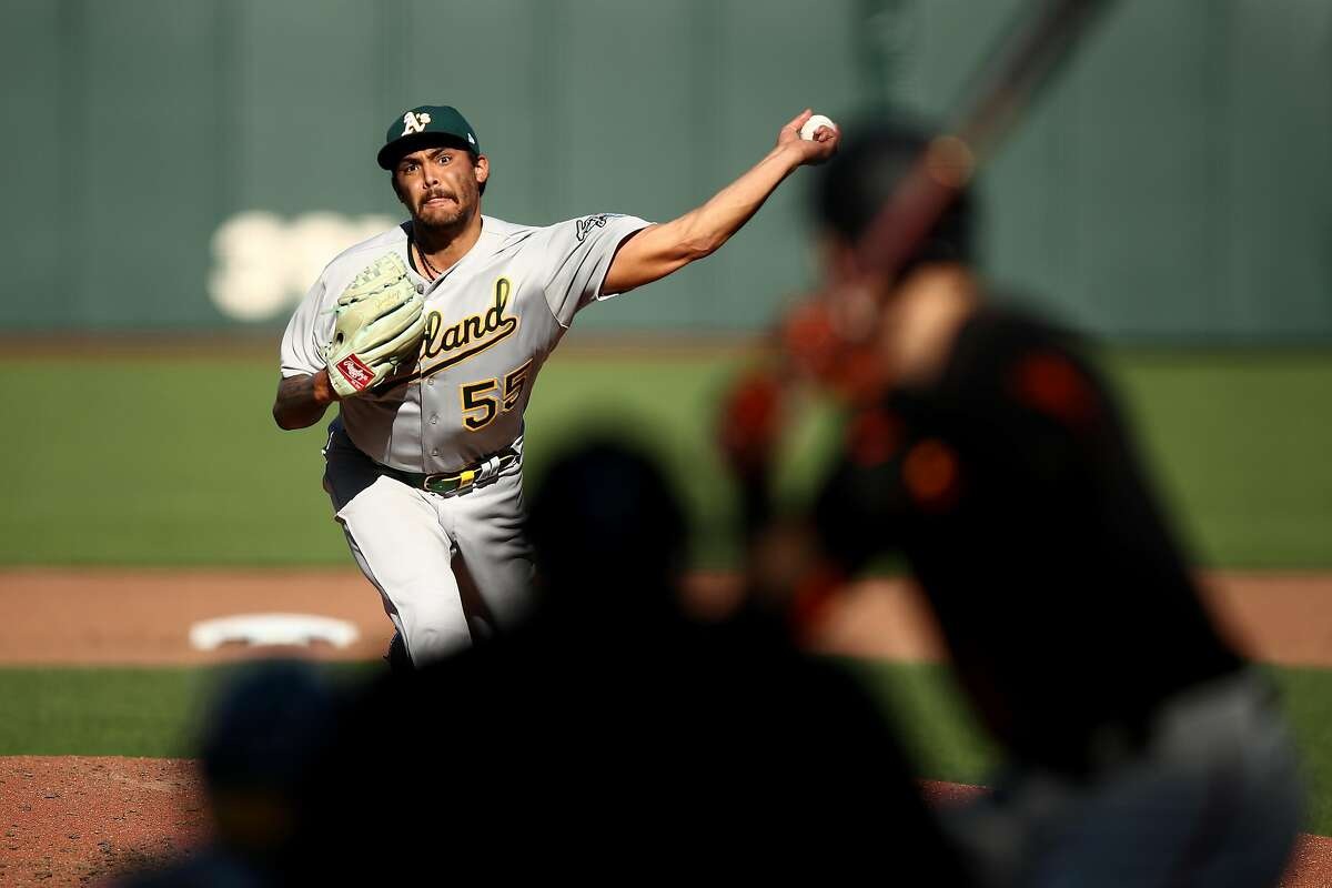 SAN FRANCISCO, CALIFORNIA - AUGUST 15: Sean Manaea #55 of the Oakland Athletics pitches against Mike Yastrzemski #5 of the San Francisco Giants in the fourth inning at Oracle Park on August 15, 2020 in San Francisco, California. (Photo by Ezra Shaw/Getty Images)
