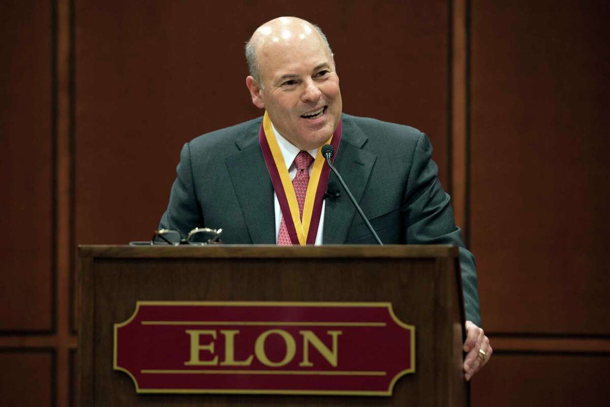 FILE - In this March 1, 2017, file photo, Elon Trustee Louis DeJoy is honored with Elon's Medal for Entrepreneurial Leadership in Elon. N.C. Mail deliveries could be delayed by a day or more under cost-cutting efforts being imposed by the new postmaster general, DeJoy. The plan eliminates overtime for hundreds of thousands of postal workers and says employees must adopt a a€ different mindseta€ to ensure the Postal Servicea€™s survival during the coronavius pandemic. (Kim Walker/Elon University via AP, File)