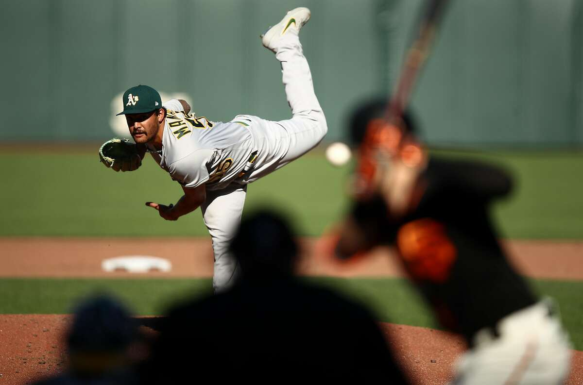 Sean Manaea #55 of the Oakland Athletics pitches against Mike Yastrzemski #5 of the San Francisco Giants in the fourth inning at Oracle Park on August 15, 2020 in San Francisco, California. (Photo by Ezra Shaw/Getty Images)