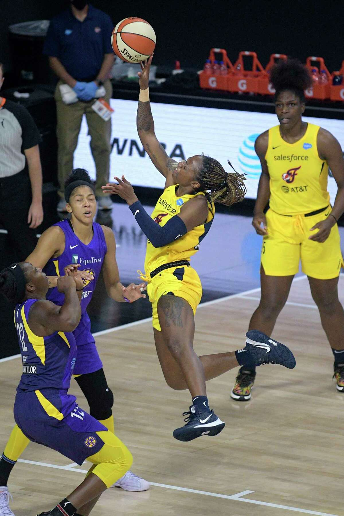 Indiana Fever guard Tiffany Mitchell goes up for a shot in front of Los Angeles Sparks forward Candace Parker and guard Chelsea Gray (12) as Fever center center Teaira McCowan, right, watches during the first half of a WNBA basketball game, Saturday, Aug. 15, 2020, in Bradenton, Fla. (AP Photo/Phelan M. Ebenhack)