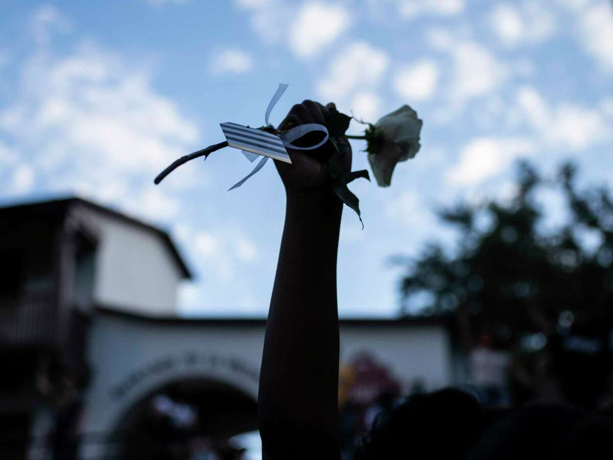 A flower is lifted during an event put on to honor the families of victims of police violence on August 15, 2020. Supporters of a San Antonio City Council resolution declaring racism a public health crisis are calling for moving funds from the San Antonio Police Department to public health to address disparities.