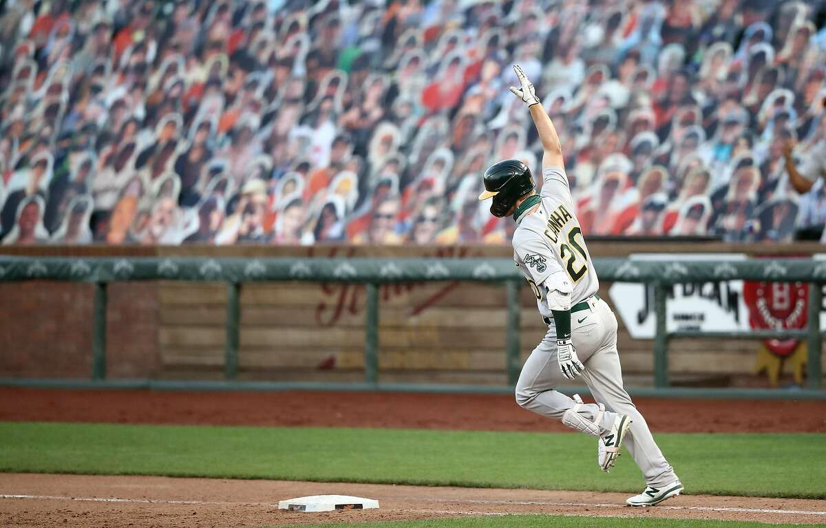 SAN FRANCISCO, CALIFORNIA - AUGUST 15: Mark Canha #20 of the Oakland Athletics rounds the bases after he hit a three-run home run on the ninth inning against the San Francisco Giants at Oracle Park on August 15, 2020 in San Francisco, California. (Photo by Ezra Shaw/Getty Images)