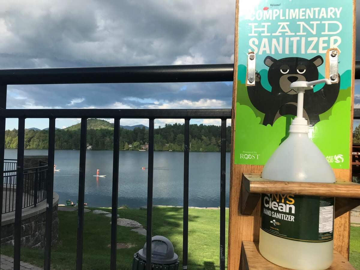 A view of Mirror Lake in the village of Lake Placid in June 2020. The vacation spot has signs it is addressing the pandemic but having hand sanitizer readily available, as well as frequent signs requesting people stay six feet apart.