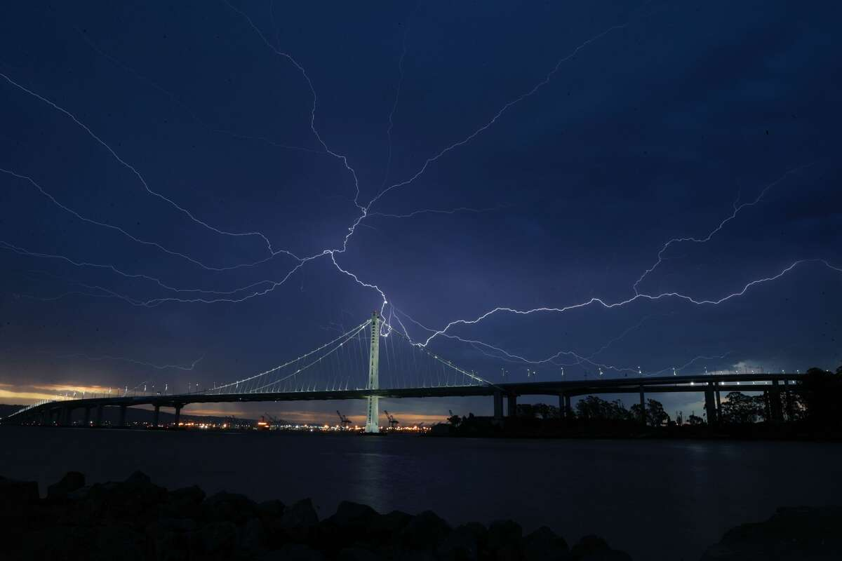 Lightning illuminates the sky over the eastern span of the Bay Bridge as a storm passed through the area on Sunday morning.