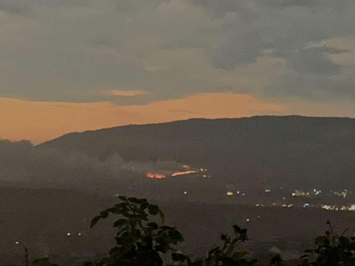 A brush fire is seen on the Pleasanton Ridge hills from San Ramon, California. Firefighters are on the scene.